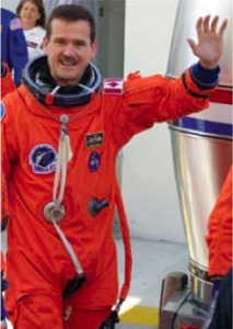 CANADIAN SPACE AGENCY ASTRONAUT AND STS-100 MISSION SPECIALIST CHRIS HADFIELD WAVES TO MEDIA ON HIS WAY TO LAUNCH PAD 39A AND LIFTOFF FOR AN 11-DAY MISSION TO THE INTERNATIONAL SPACE STATION. CREDIT NASA